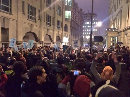 iamge of Protesters surround Charring Cross police station in London